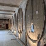 Cidrerie Beuzeville - Façade de cuves à cidre comme des masques